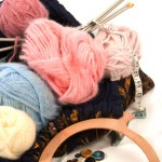 Knitting bag, needles, yarn and buttons