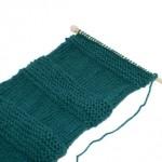 Scarf on knitting needles