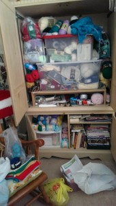 armoire stuffed with my knitting things